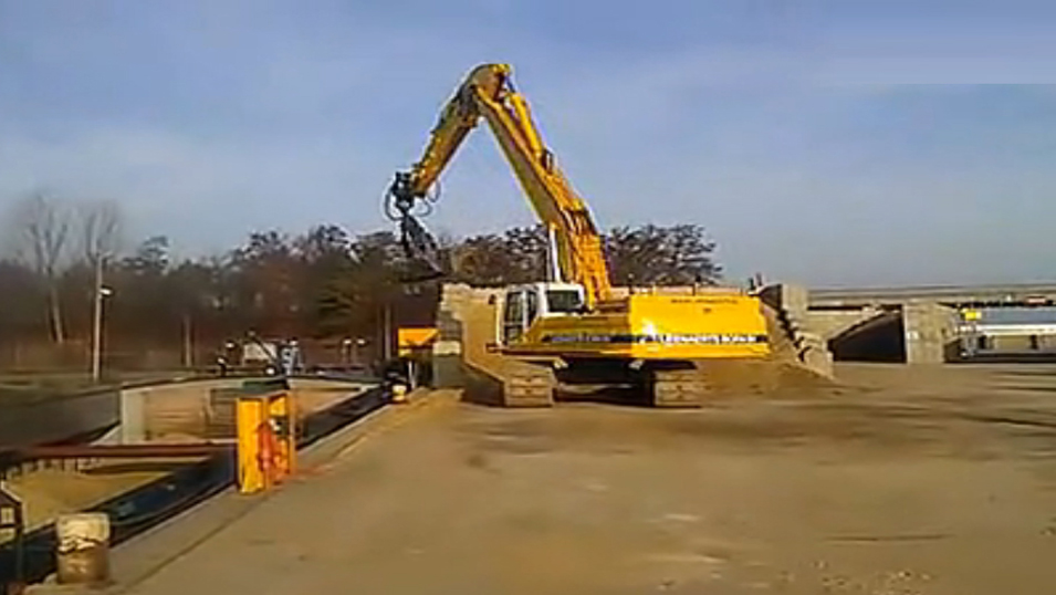 Doosan DX420LC long arm excavator loading sand boat